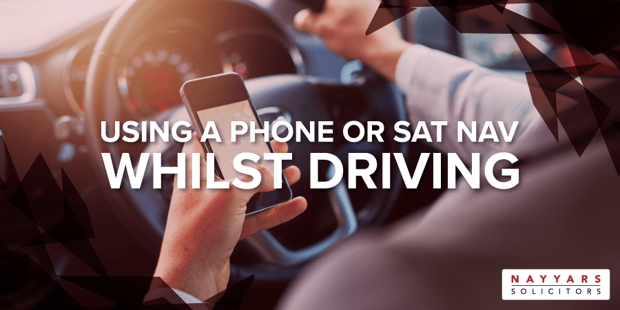 Using a Phone or Sat Nav Whilst Driving