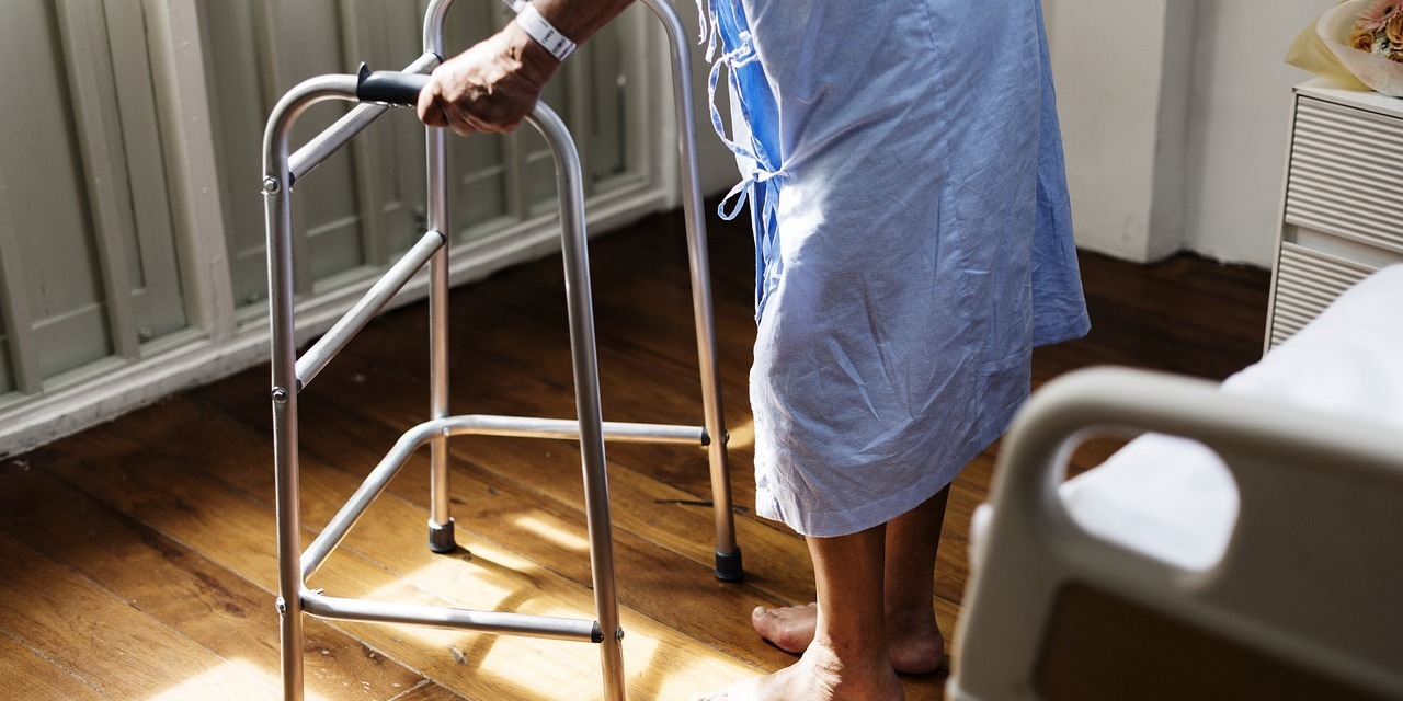 man-in-hospital-gown-using-walker-after-medical-negligence