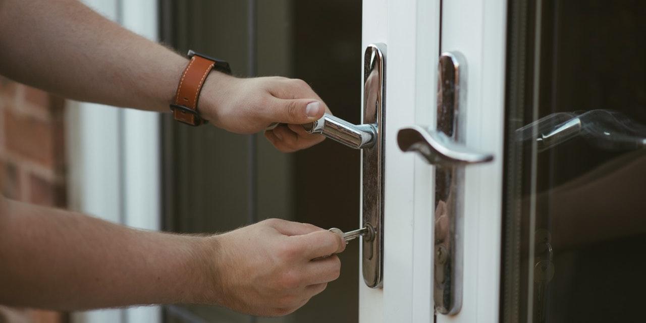 man-trying-to-unlock-patio-door