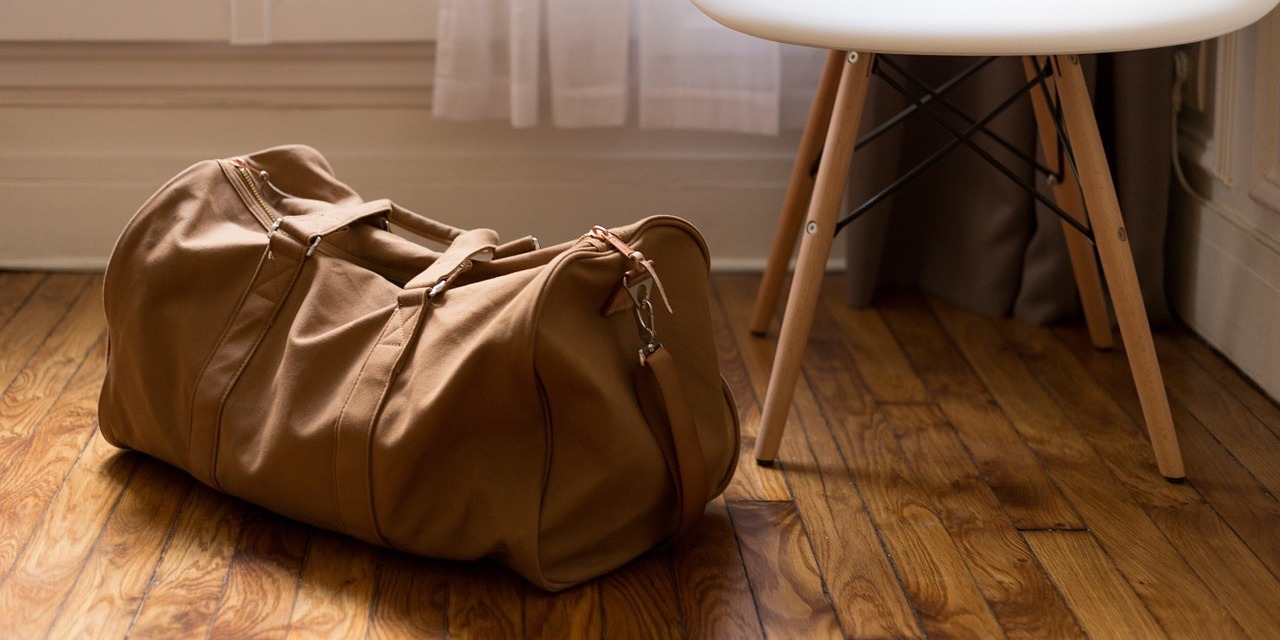 mans-bag-packed-on-floor