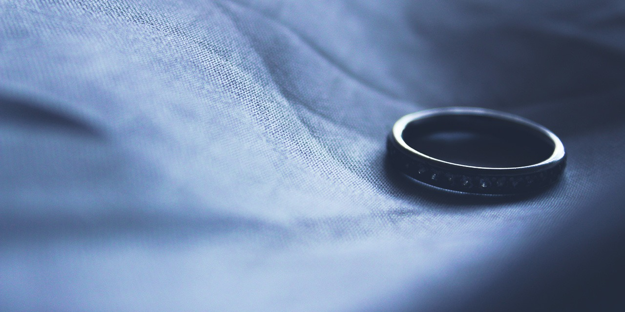 wedding-ring-left-on-bed