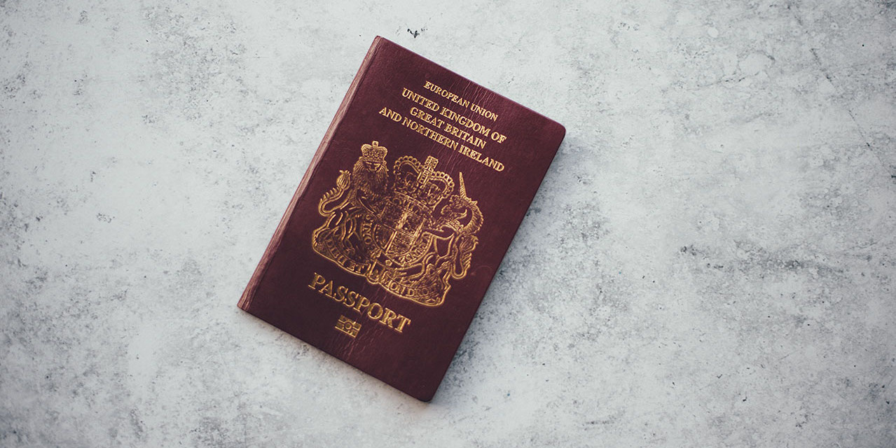 uk-passport-on-grey-stone-surface
