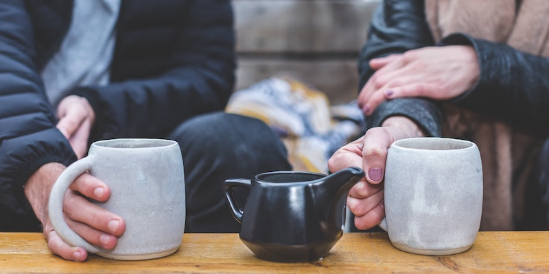 man-and-woman-drinking-coffee-together