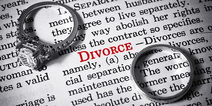 two-wedding-rings-on-dictionary-page-next-to-divorce-definition